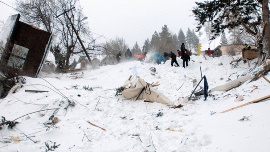 FEB. 28: Rescuers dig at the scene of an avalanche in Missoula's Rattlesnake Valley.