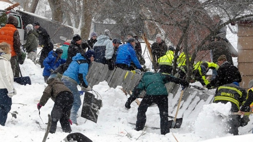 FEB. 28: Rescuers look for a boy buried in the snow in Missoula's Rattlesnake Valley.