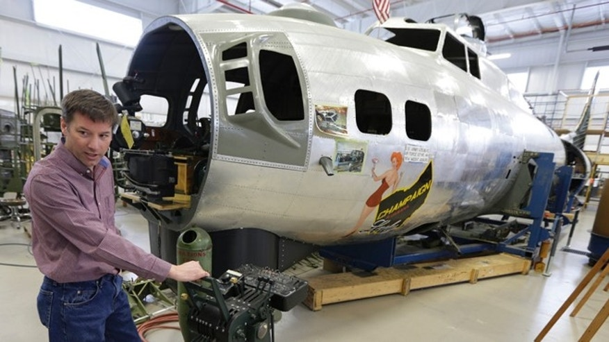 Feb. 20, 2014: Dave Shiffer displays a throttle quadrant that will be placed in the B-17 World War II-era bomber being built from salvaged and fabricated parts at the Champaign Aviation Museum in Urbana, Ohio.
