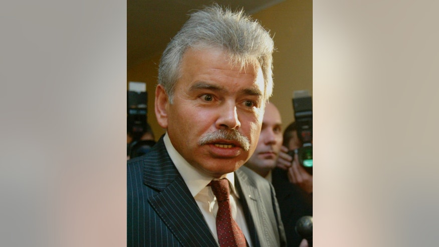 FILE - In this Dec. 4, 2003 file photo Russian businessman Yuri Borisov speaks in Vilnius, Lithuania. Yuri Borisov's performance on a lucrative U.S. military contract was dismal. Cost overruns. Blown deadlines. Forged paperwork. Yet that didn't keep the Russian entrepreneur from winning more business with the Department of Defense, according to interviews and documents obtained by The Associated Press. Borisov, who specializes in refurbishing Russian Mi-17 helicopters, had an ally in Bert Vergez, an Army colonel who ran an obscure DOD acquisition office in Huntsville, Ala. (AP Photo/Mindaugas Kulbis, File)