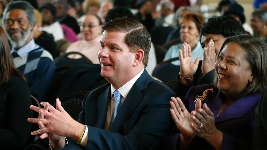 "Boston Mayor Martin Walsh applauds as he attends a Black History Month event in Boston, Thursday, Feb. 27, 2014. The mayors of New York City and Boston say they'll boycott St. Patrick's Day parades to protest policies on gay groups. Walsh said this week he's trying to broker a deal with his city's parade organizers to allow a group of gay military veterans to march. The son of Irish immigrants said that allowing gay groups to participate is ""long overdue."" (AP Photo/Elise Amendola)"