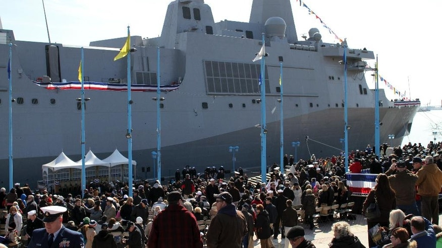 Audience members gather before the start of a commissioning ceremony for the USS Somerset (LPD 25) Saturday, March 1, 2014, in Philadelphia. The USS Somerset is the ninth San Antonio-class amphibious transport dock and the third of three ships named in honor of those victims and first responders of the attacks on the World Trade Center and the Pentagon.  The ship is named for the county where Flight 93 crashed after being hijacked on Sept. 11, 2001. (AP Photo/ Joseph Kaczmarek)