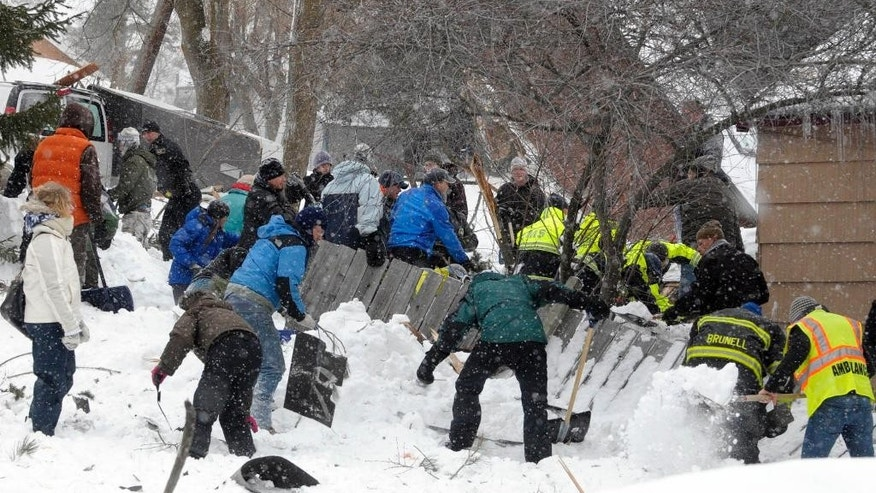 Rescuers dig frantically at the scene of an avalanche in Missoula's Rattlesnake Valley on Friday, Feb. 28, 2014, looking for a boy buried in the snow. The avalanche roared into a residential neighborhood and destroyed a house, but three people were found alive amid the snow and wreckage, police said. The survivors were an elderly couple and an 8-year-old boy, police Sgt. Travis Welsh said. St. Patrick Hospital spokeswoman says the three remained hospitalized Saturday, a day after the avalanche slid down Mount Jumbo into the northeast Missoula neighborhood. The hospital says 66-year-old Fred Allendorf is in serious condition while his wife, Michel Colville, is in critical condition. An 8-year-old boy whose name hasn't been released is in fair condition.  (AP Photo/The Missoulian, Tom Bauer)