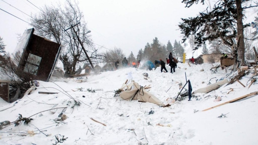 Rescuers dig at the scene of an avalanche in Missoula's Rattlesnake Valley on Friday, Feb. 28, 2014. The avalanche roared into a residential neighborhood and destroyed a house, but three people were found alive amid the snow and wreckage, police said. The survivors were an elderly couple and an 8-year-old boy, police Sgt. Travis Welsh said.  St. Patrick Hospital spokeswoman says the three remained hospitalized Saturday, a day after the avalanche slid down Mount Jumbo into the northeast Missoula neighborhood. The hospital says 66-year-old Fred Allendorf is in serious condition while his wife, Michel Colville, is in critical condition. An 8-year-old boy whose name hasn't been released is in fair condition.  (AP Photo/The Missoulian, Tom Bauer)