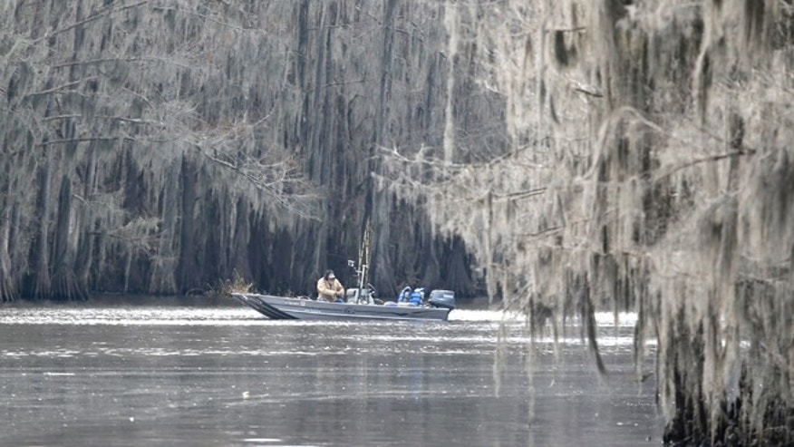 Feb. 26: A fisherman works Caddo Lake near Uncertain, Texas.