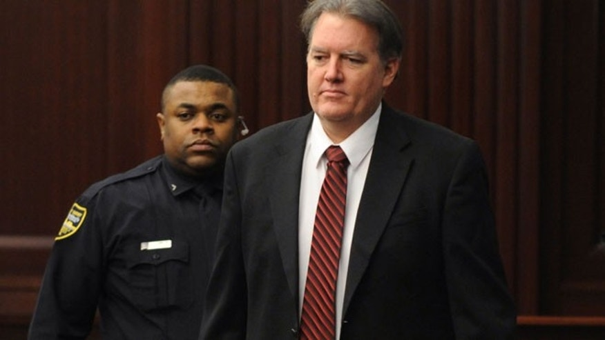 Defendant Michael Dunn is brought into the courtroom in this Feb. 15, 2014 file photo where Judge Russell Healey announced that the jury was deadlocked on charge one and have verdicts on the other four charges as they deliberate in the trial of Dunn, for the shooting death of Jordan Davis in November 2012.