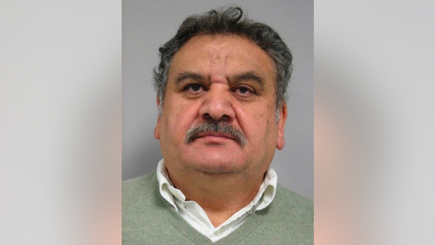 This December 2013 photo provided by the Palatine Police Department in Palatine, Ill., shows Branko Bogdanov, 58, of Northbrook, Ill. On Monday, March 10, 2014, a federal judge in Chicago is scheduled to decide whether Bogdanov, his 52-year-old wife Lela Bogdanov and their 34-year-old daughter, Julia Bogdanov, charged in an alleged $7 million shoplifting spree must stay behind bars. They were arrested last week at their luxury home in Northbrook. They are charged with one count each of interstate transportation of stolen property. (AP Photo/Courtesy of the Palatine Police Department)