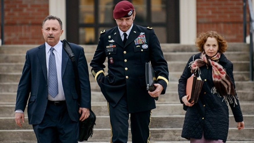 In this March 4, 2014 file photo, Brig. Gen. Jeffrey Sinclair leaves the courthouse with his lawyers Richard Scheff, left, and Ellen C. Brotman, following a day of motions at Fort Bragg, N.C.