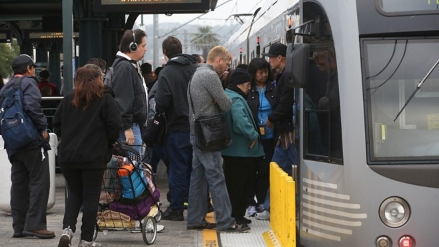 March 7, 2014: Pedestrians board a train at Union Station in Los Angeles. Americans are boarding public buses, trains and subways in greater numbers than any time since the suburbs began to boom. Nearly 10.7 billion trips in 2013, to be precise, the highest number since 1956.