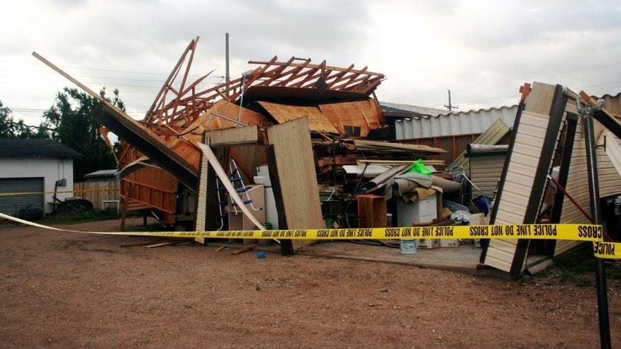 "FILE - In this May 31, 2007, file photo, a structure is destroyed after a tornado briefly touched down in Guymon, Okla. The National Weather Service in Norman has used Twitter and Facebook for years to disseminate weather warnings. But they tried a new approach recently, holding an online ""tornado drill."" (AP Photo/Guymon Daily Herald, Heather Avey, File)"