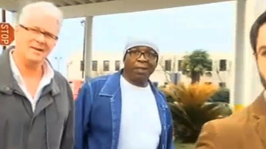 In this frame grab from video provided by WAFB-TV 9, Glenn Ford, 64, center, walks out of a maximum security prison, Tuesday, March 11, 2014, in Angola, La., after having spent nearly 26 years on death row. Ford walked free Tuesday evening hours after a judge approved the state's motion to vacate his murder conviction in the 1983 killing of a jeweler. State District Judge Ramona Emanuel on Monday took the step of voiding Ford's conviction and sentence based on new information that corroborated his claim that he was not present or involved in the murder. (AP Photo/WAFB-TV 9)
