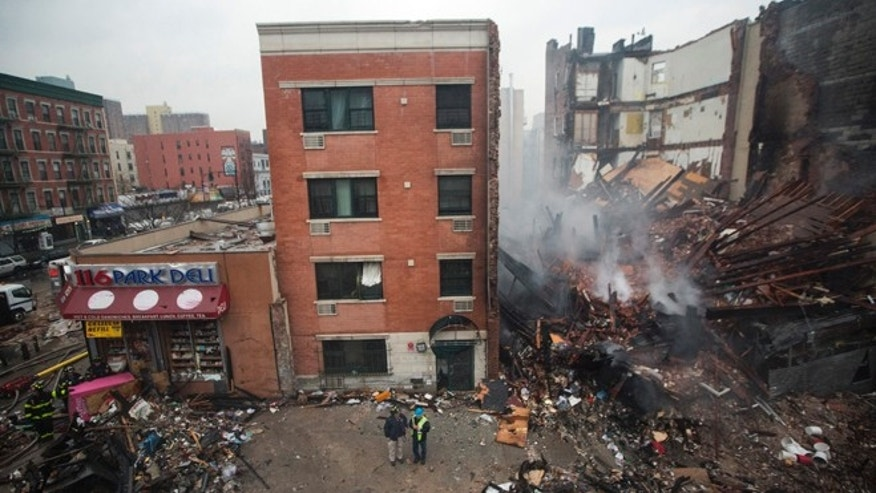 MARCH 12: New York City emergency responders work at the site of a building explosion and collapse in the Harlem section of New York.