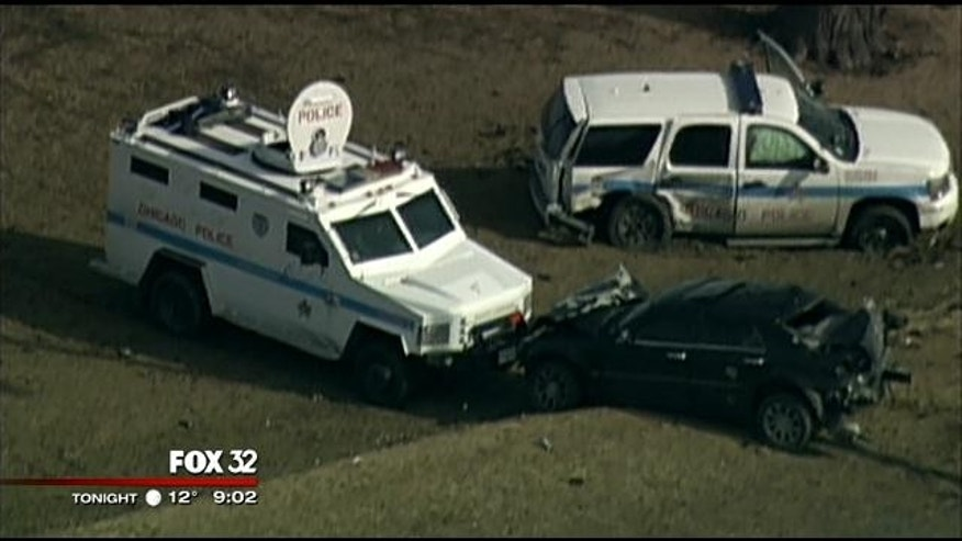 March 16, 2014: Police vans surround the car driven by Joseph Andrew Felton Jr. after it crashed following at police chase on Lake Shore Drive in Chicago. (MyFoxChicago.com)