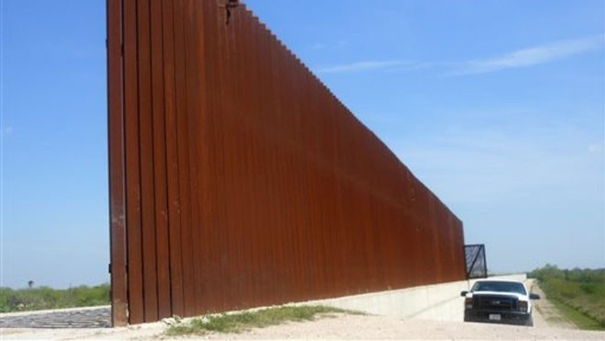 March 15, 2014: This photo shows a border patrol vehicle patrolling along the Abram border fence in Abram, Texas. (AP)
