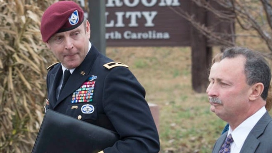 March 17, 2014: Brig. Gen. Jeffrey Sinclair, left,  leaves the Fort Bragg courthouse with his defense attorney Richard Scheff.