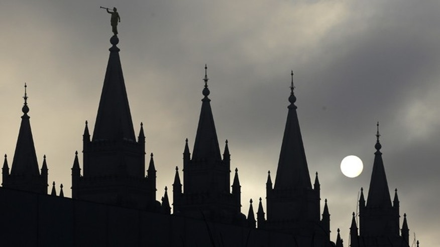 FILE: The angel Moroni statue, silhouetted against a cloud-covered sky, sits atop the Salt Lake Temple in Temple Square in Salt Lake City.