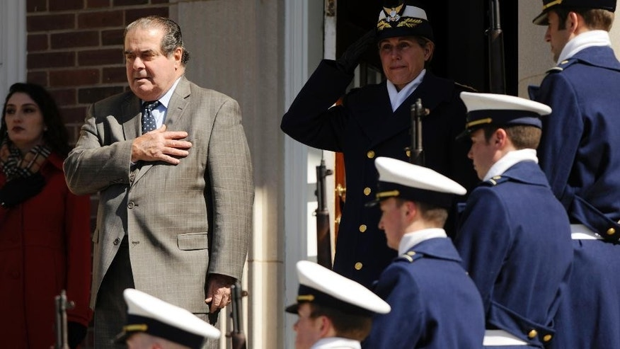 U.S. Supreme Court Justice Antonin Scalia, left, stands with United States Coast Guard Academy Superintendent Rear Adm. Sandra Stosz on the steps of Hamilton Hall  after being welcomed to the academy Tuesday, March 18, 2014, in New London, Conn. Scalia will address the corps of cadets this Tuesday night as the 2014 Hedrick Fellow. The Hedrick Fellow program brings renowned political, military and industry leaders to the academy to share their knowledge and insight. (AP Photo/The Day, Sean D. Elliot)  MANDATORY CREDIT
