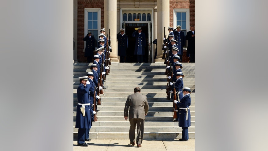 U.S. Supreme Court Justice Antonin Scalia is welcomed to the United States Coast Guard Academy by an honor guard of cadets and Superintendent Rear Adm. Sandra Stosz on the steps of Hamilton Hall at the academy Tuesday, March 18, 2014, in New London, Conn. Scalia will address the corps of cadets this Tuesday night as the 2014 Hedrick Fellow. The Hedrick Fellow program brings renowned political, military and industry leaders to the academy to share their knowledge and insight. (AP Photo/The Day, Sean D. Elliot)