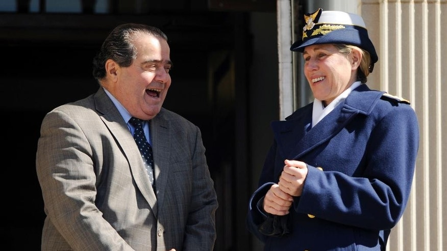 U.S. Supreme Court Justice Antonin Scalia chats with United States Coast Guard Academy Superintendent Rear Adm. Sandra Stosz on the steps of Hamilton Hall  after being welcomed to the academy Tuesday, March 18, 2014, in New London, Conn. Scalia will address the corps of cadets this Tuesday night as the 2014 Hedrick Fellow. The Hedrick Fellow program brings renowned political, military and industry leaders to the academy to share their knowledge and insight. (AP Photo/The Day, Sean D. Elliot)  MANDATORY CREDIT