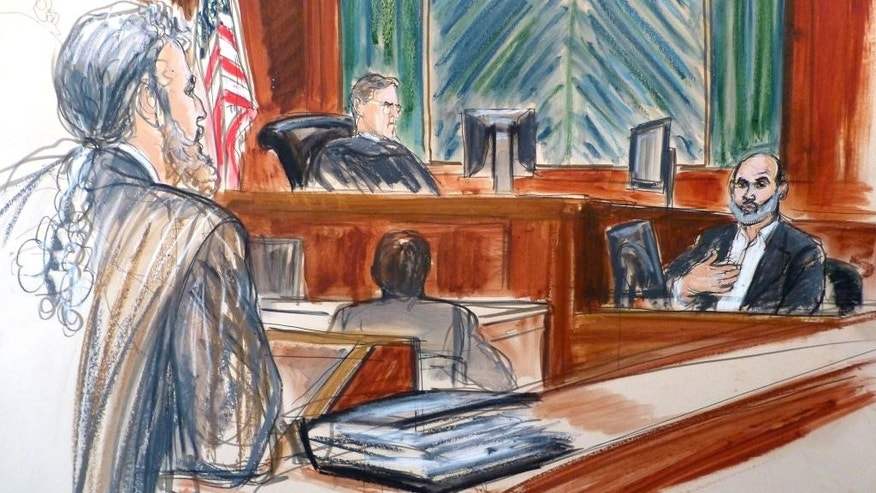 "In this courtroom sketch, Osama bin Laden's son-in-law Sulaiman Abu Ghaith, right, testifies at his trial Wednesday, March 19, 2014, in New York, on charges he conspired to kill Americans and aid al-Qaida as a spokesman for the terrorist group.  Listening to testimony are Judge Lewis Kaplan, center, and defense attorney Stanley Cohen, at podium. In his surprise testimony, Abu Ghaith recounted the night of the Sept. 11, 2001, attacks, when the al-Qaida leader sent a messenger to drive him into a mountainous area for a meeting inside a cave in Afghanistan. ""Did you learn what happened? We are the ones who did it,"" Abu Ghaith, recalled bin Laden telling him. (AP Photo/Elizabeth Williams)"