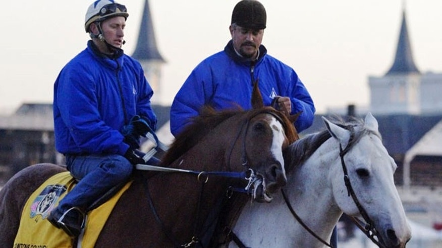 April 28, 2004, In this photo, trainer Steve Asmussen, right, leads Kentucky Derby hopeful Quintons Gold Rush and exercise rider Scott Blasi off the track after a morning workout at Churchill Downs in Louisville, Ky.