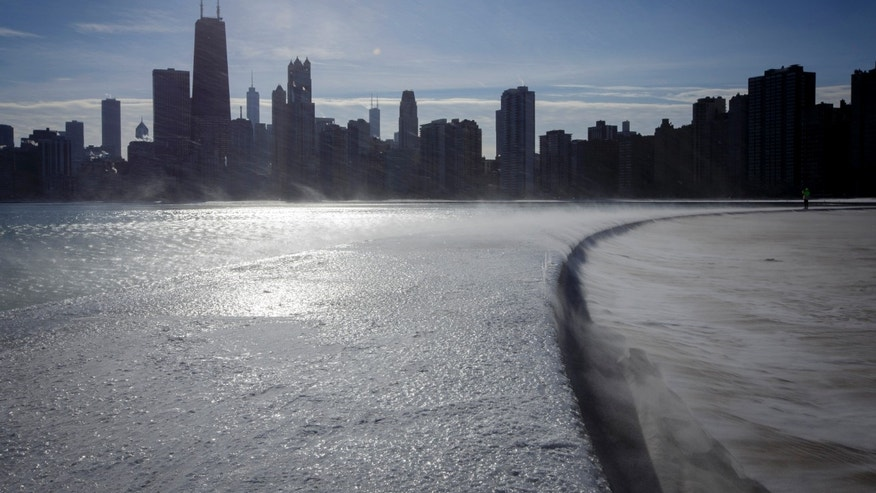 December 12, 2013: Ice covers the shore of Lake Michigan in Chicago. All five of the Great Lakes have had ice covering 92% of the surface which will likely lead to higher water levels into the spring and fall.