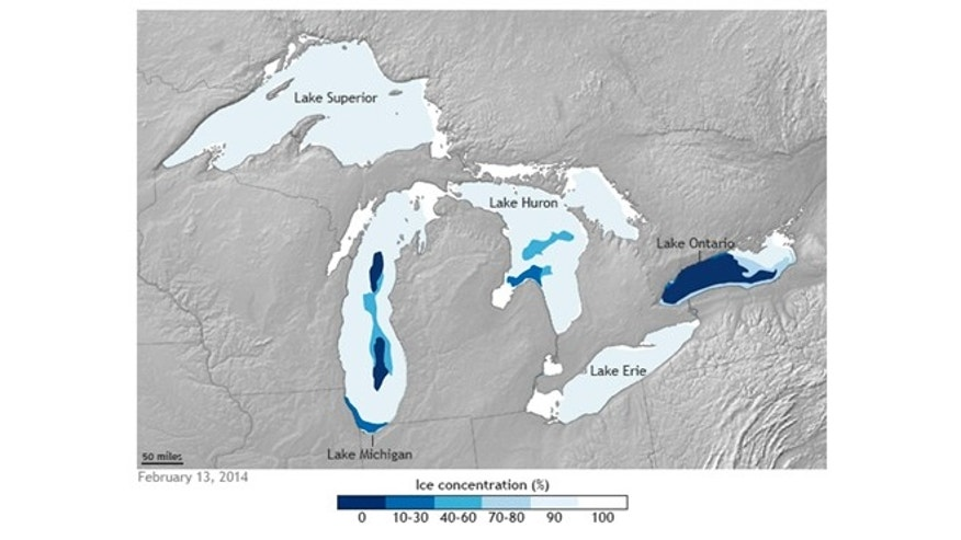 A map by NOAA Climate.gov, shows ice coverage on the Great Lakes on February 13, 2014. Varying shades of blue indicate ice concentration levels throughout the region.