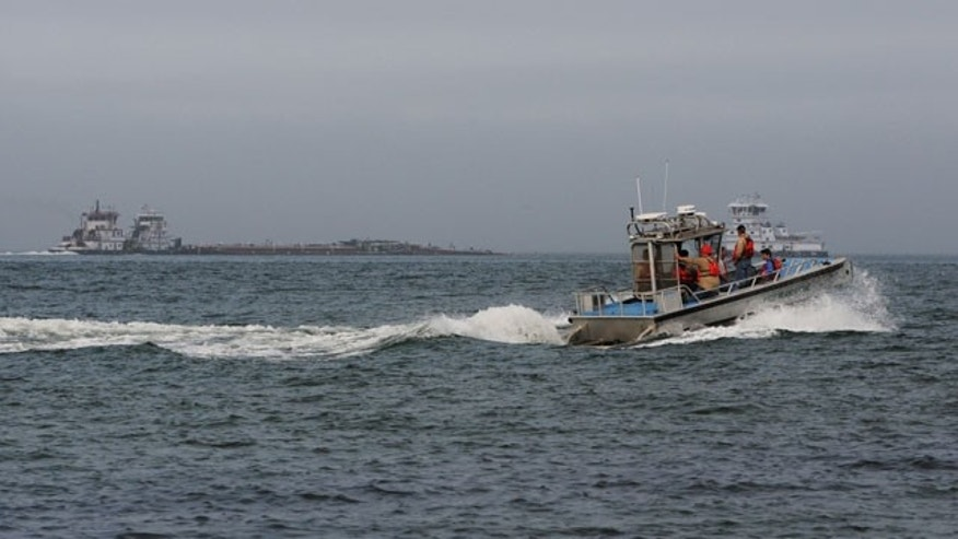 March 22, 2014: A response boat heads to the scene of a collision between a ship and barge in the ship channel near the Texas City Dike. Two workers on one of the vessels were exposed to hydrogen sulfide and decontaminated by the first department at the end of the dike. (AP Photo/The Galveston County Daily News, Neal Mora)