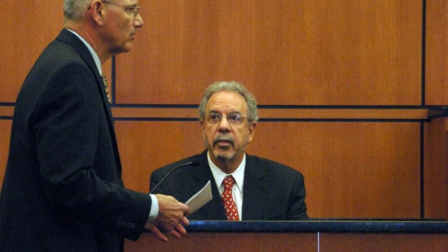Defense attorney Al Avignone, left, questions psychologist Greg Olley during testimony, Monday, March 24, 2014 in Sidney, Mont. on whether a Colorado man should stand trial in the 2012 killing of a Montana teacher. Olley testified that 24-year-old defendant Michael Keith Spell has an intelligence level comparable to an 11-year-old and is not fit for trial. (AP Photo/Matthew Brown)