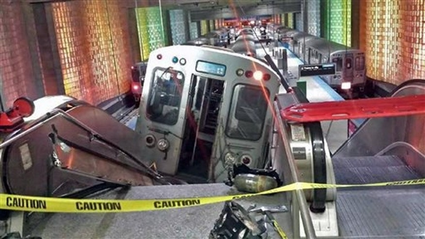 March 24: A Chicago Transit Authority train car rests on an escalator at the O'Hare Airport station after it derailed early Monday in Chicago.