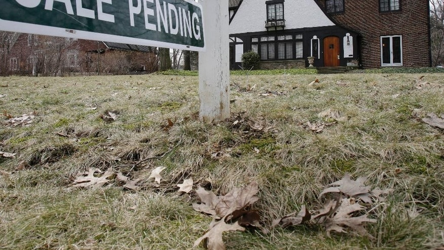 This Friday, March 21, 2014 photo shows a home for sale in Shaker Heights, Ohio. Standard & Poor's releases S&P/Case-Shiller index of home prices for January, on Tuesday, March 25, 2014. (AP Photo/Tony Dejak)