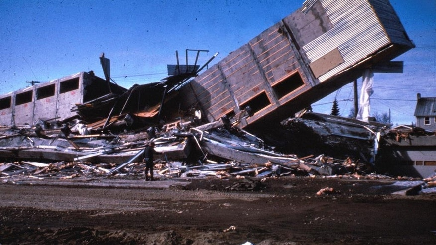 In this March 1964, photo released by the U.S. Geological Survey, the Four Seasons Apartments, a six-story lift-slab reinforced concrete building is shown cracked to the ground following an earthquake in Anchorage, Alaska. The building was under construction, but structurally completed at the time of the quake. North America's largest earthquake rattled Alaska 50 years ago, killing 15 people and creating a tsunami that killed 124 more from Alaska to California. The magnitude 9.2 quake hit at 5:30 p.m. on Good Friday, turning soil beneath parts of Anchorage into jelly and collapsing buildings that were not engineered to withstand the force of colliding continental plates. (AP Photo/U.S. Geological Survey)