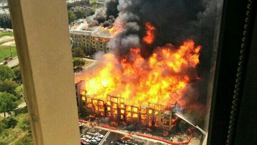 Mar. 25, 2014: In this photo provided by Christopher  Laski a large apartment complex under construction is consumed by fire, sending black smoke billowing into the sky and drawing hundreds of emergency personnel in Houston.