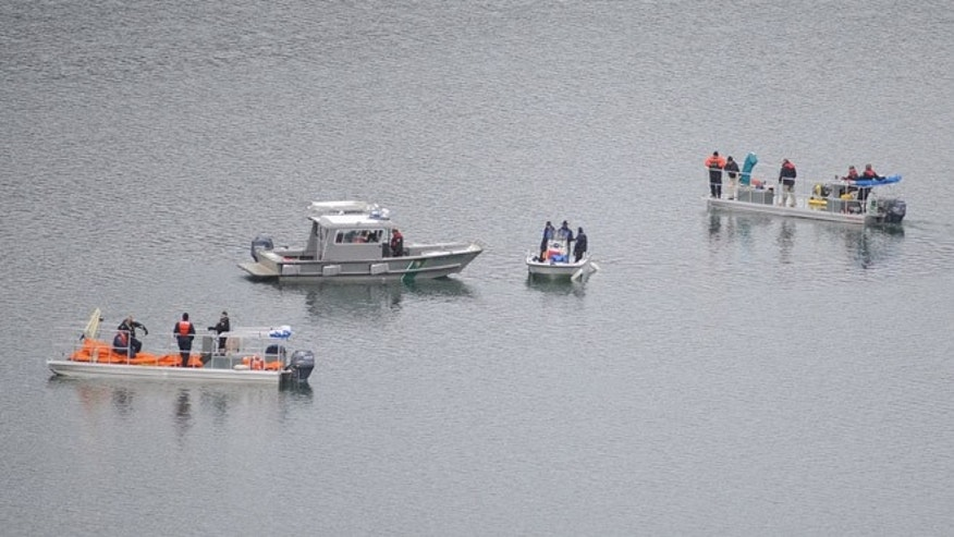 Mar. 27, 2014: This photo released by Ouray County, shows salvage operations to recover the victims and plane at the Ridgway Reservoir near Ridgway, Colo., at the site of a downed aircraft, which crashed last Saturday, March 22, 2014, killing five people from Alabama.