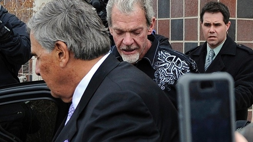 MARCH 17: Colts owner Jim Irsay, center, leaves the Hamilton County Jail in Indianapolis.