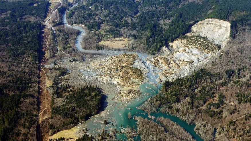 10ThingsToSee  - This aerial photo taken Monday, March 24, 2014 shows the massive mudslide that killed at least eight people Saturday and left dozens missing, near Arlington, Wash. (AP Photo/Ted S. Warren, File)