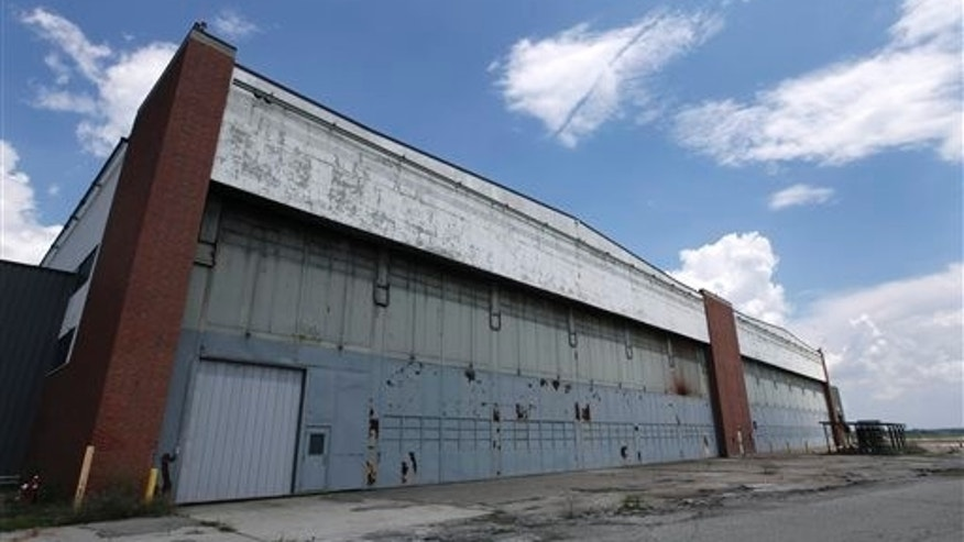 In this July 17, 2013 file photo is part of the former Willow Run Bomber Plant at Willow Run Airport in Ypsilanti Township, Mich. The factory went back to making automobiles after the World War II ended, and it did so for more than a half-century under the General Motors name before closing for good in 2010.