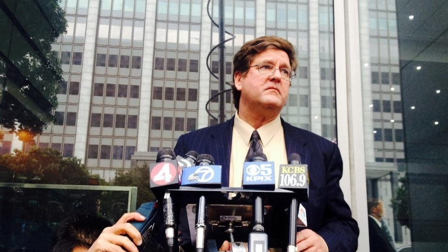 Attorney Paul Demeester reads a letter that California state Sen. Leland Yee sent to California Secretary of State Debra Bowen on Thursday, March 27, 2014 informing her that he was withdrawing his candidacy, during a news conference in San Francisco.  The California state senator accused of accepting bribes and introducing an undercover agent to an arms trafficker is dropping out of the race for California secretary of state.  State legislators have called on Yee to step down from the state Senate. Asked whether Yee planned to do that, DeMeester declined to comment. (AP Photo/Paul Elias)