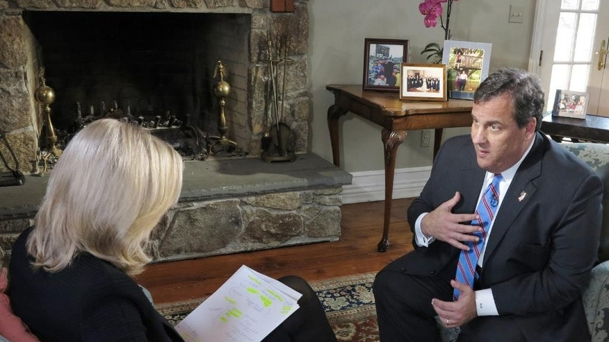 "In this photo provided by ABC News, ABC News' Diane Sawyer speaks exclusively to New Jersey Governor Chris Christie at his home in Mendham, N.J., Thursday, March 27, 2014.  The Governor insisted that he ""did nothing to create the environment"" that prompted some of his former top aides to cause a traffic nightmare at the George Washington Bridge last fall.  Portions of the interview aired on World News with Diane Sawyer and will also air on Nightline. Good Morning America Also plans to air some of the interview on Friday, March 28.  (AP Photo, ABC, Ida Mae Astute) NO BOOK PUBLISHING WITHOUT PRIOR APPROVAL,; NO ARCHIVE; NO RESALE."