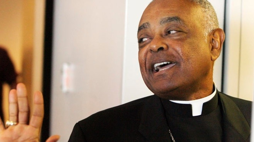 FILE 2008: Archbishop Wilton Gregory of Atlanta exits the St. Clair County Courthouse in Belleville, Ill.