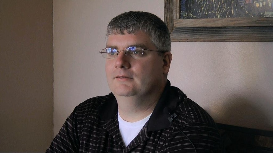 This March 14, 2014 frame grab taken from video, shows Rob McGahen in Pensacola, Fla. McGahen, 30, hasn't yet found a job that paid as well as the purchasing agent position at Boeing's defense division that he left in 2011. Nervous about the sustainability of that job because of government defense cuts, McGahen quit after buying a bar near his St. Louis home. (AP Photo/Melissa Nelson)