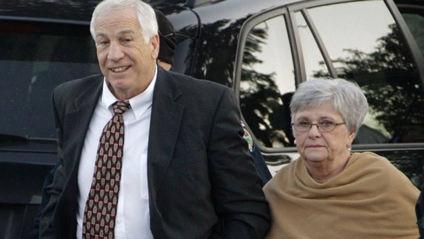 Dec. 13, 2011: In this file photo, former Penn State assistant football coach Jerry Sandusky arrives with his wife, Dottie Sandusky, for a preliminary hearing at the Centre County Courthouse in Bellefonte, Pa.