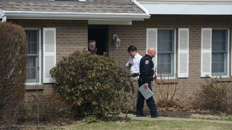 "In this photo taken on April 1, 2014, police investigate at the scene where two children, Daniel Schlemmer, 6 and Luke Schlemmer, 3, were found unresponsive in a bathtub at a home in McCandless, Pa. The mother Laurel Michelle Schlemmer, 40, was jailed without bond after she was arraigned early Wednesday, April 2, 2104, on charges including criminal homicide, aggravated assault and child endangerment. Police said in a criminal complaint, that Schlemmer heard ""crazy voices"" telling her to push her sons underwater before she sat on the boys in the bathtub, drowning her son Luke and leaving his brother Daniel in critical condition. (AP Photo/Pittsburgh Post-Gazette, Lake Fong)  MAGS OUT; NO SALES; MONESSEN OUT; KITTANNING OUT; CONNELLSVILLE OUT; GREENSBURG OUT; TARENTUM OUT; NORTH HILLS NEWS RECORD OUT; BUTLER OUT"