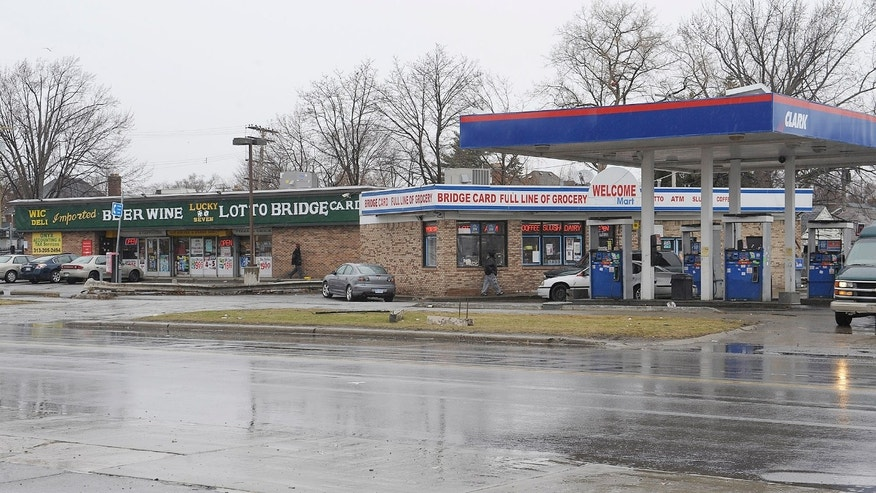 April 3, 2014: Cars enter local business at the scene of an attack on Wednesday at the street corners of Morang and Balfour in Detroit.