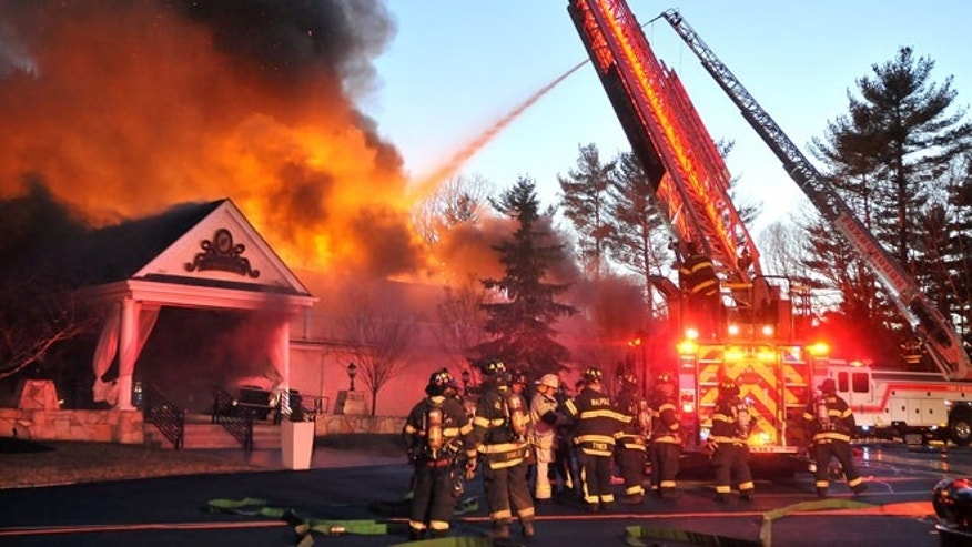 April 5, 2014: Firefighters respond to a multiple alarm fire at the popular Lakeview Pavilion in Foxboro, Mass.