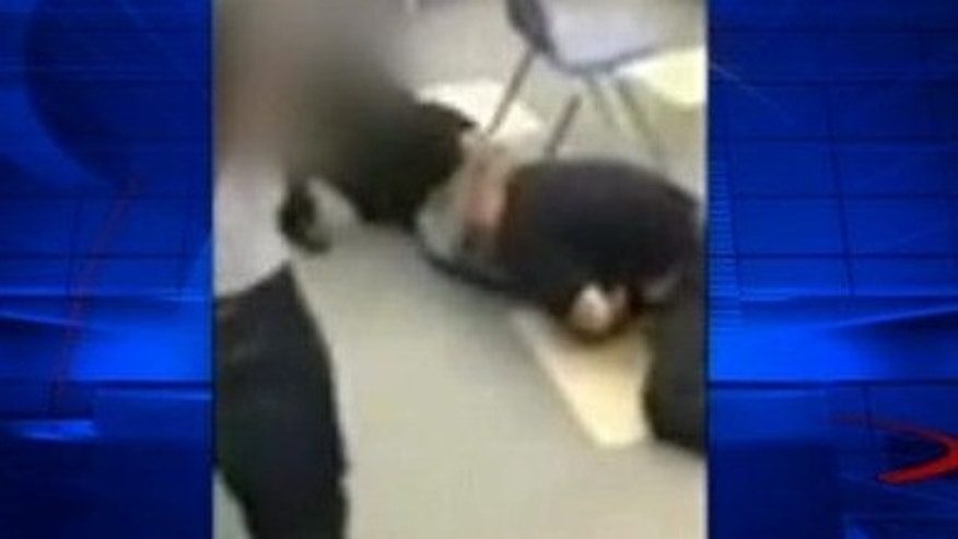 A screen grab of the video, obtained by Fox affiliate KTTV, shows the teacher fighting with a student.