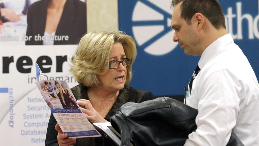 FILE - In this Wednesday, Jan. 22, 2014 file photo, recruiter Valera Kulow, left, speaks with job seeker Leonardo Vitiello during a career fair in Dallas. The Labor Department's job openings and labor turnover survey for February is released on Tuesday, April 8, 2014. (AP Photo/LM Otero, File)