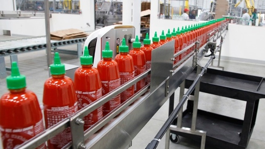 Oct. 29, 2013: This photo shows Sriracha chili sauce moves along a production line during at the Huy Fong Foods factory in Irwindale, Calif.