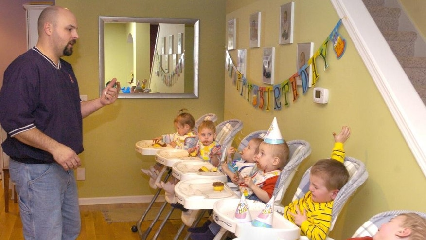 In this photo taken in January 2006, Ben Van Houten keeps a close watch on his sons and daughters as they eat their cupcakes, celebrating their second birthdays in Holland, Mich. The children are, from back to front: Samantha, Kennedy, Peyton, Nolan, John and Gerrit.   A relative says Ben Van Houten suffered a fatel heart attack Wednesday night, April 9, 2014, after setting up a trampoline at his home in the Holland-area in western Michigan. The father of Michigan's first surviving set of sextuplets was 39.  (AP Photo/The Grand Rapids Press, Cory Olsen) ALL LOCAL TV OUT; LOCAL TV INTERNET OUT