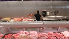 July 25, 2012: In this file photo butcher Freddie Quina cuts meat at Super Cao Nguyen in Oklahoma City.